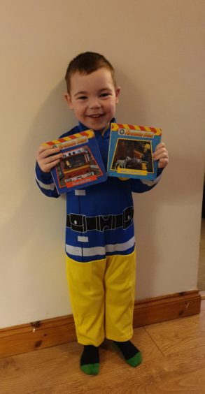 Dylan Morrison, 3, is ready for action with his Fireman Sam outfit