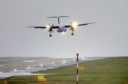 A plane lands in crosswinds as Storm Gareth hits the UK