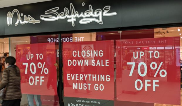 Signs were posted in the window at Miss Selfridge