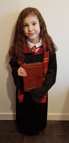 Olivia Graham, 7, dressed as Hermione Granger from the Harry Potter books