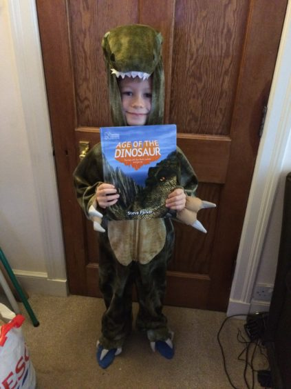 Hamish McPherson, 7, dressed as a T Rex