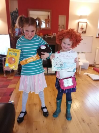 Sacha, 8, as Myrtle Meek holding Fing and Erin, 6, as Katie Morag