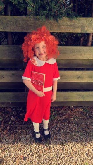 Lyla Wood, 5, dressed up as orphan Annie from the popular musical