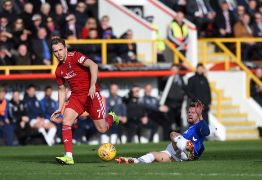 Pictured are Aberdeen's Greg Stewart and Rangers' Joe Worrall Picture by Darrell Benns