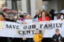 The large protest against potential cutbacks to services was held outside the council chambers before the meeting
