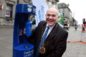 Lord Provost Barney Crockett tries out the water
