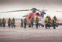 by Allister Thomas - 26/03/2019 5:39 pm  Offshore workers with a CHC helicopter at Aberdeen heliport