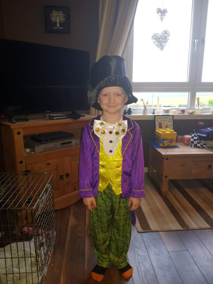 Alfie Gibson, 6, is colourful as Charlie and the Chocolate Factory's Willy Wonka