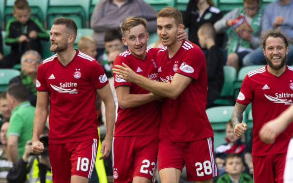 Aberdeen's Tommie Hoban celebrates his opener with team-mate Frank Ross, left.