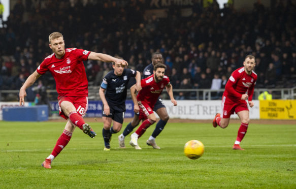 Aberdeen's Sam Cosgrove scores from the spot.