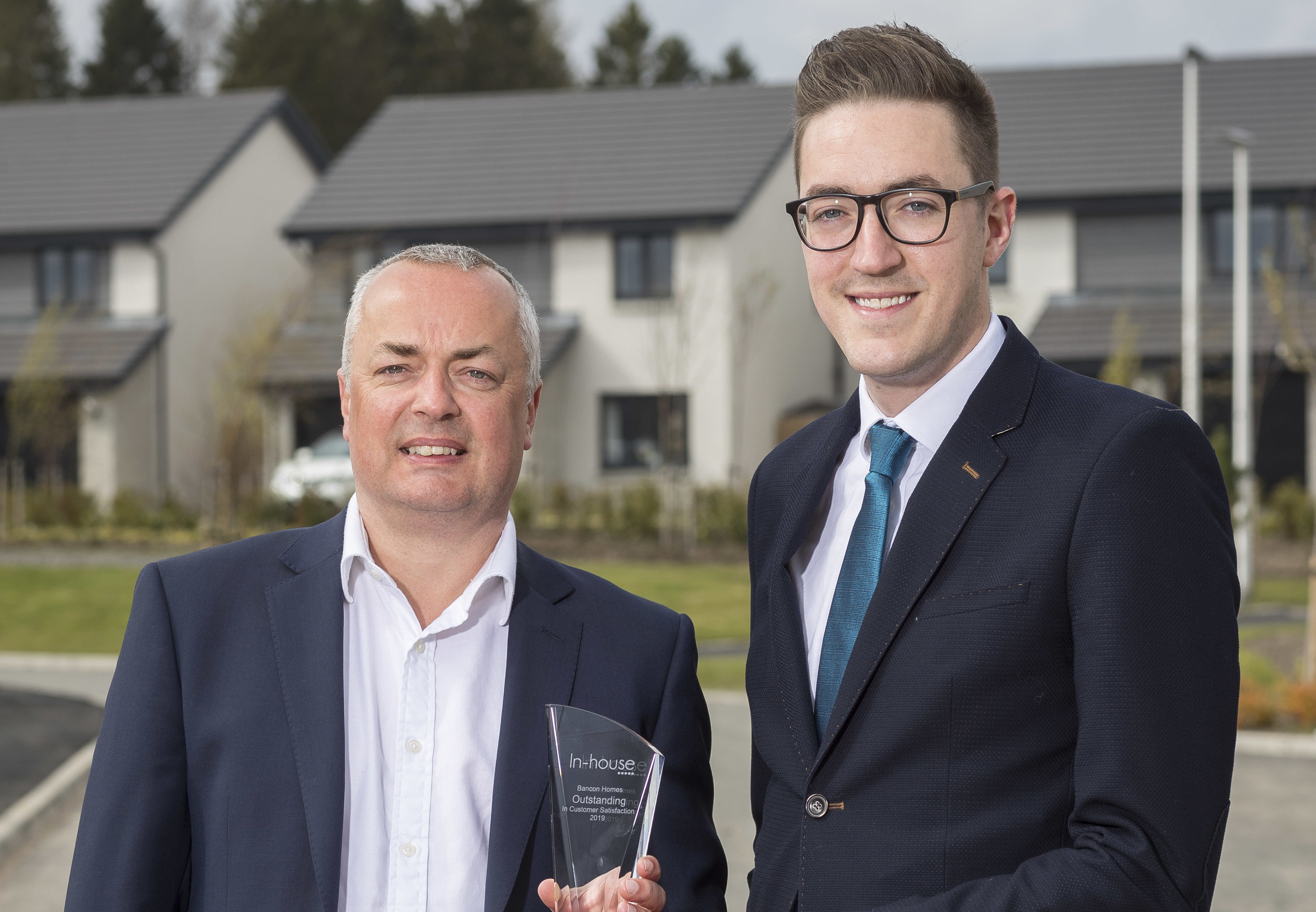 Allan Clow (left), managing director of Bancon Homes, is pictured receiving the award from Tom Weston, chief operating officer at In-House Research.