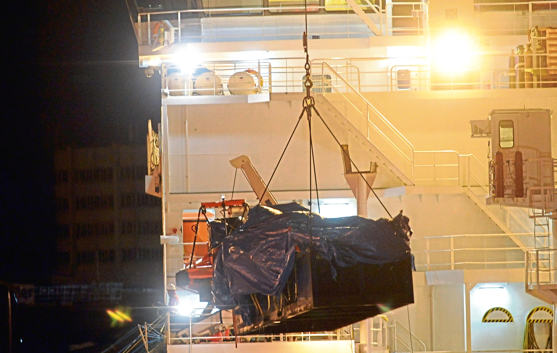 Unloading wreckage in 2009