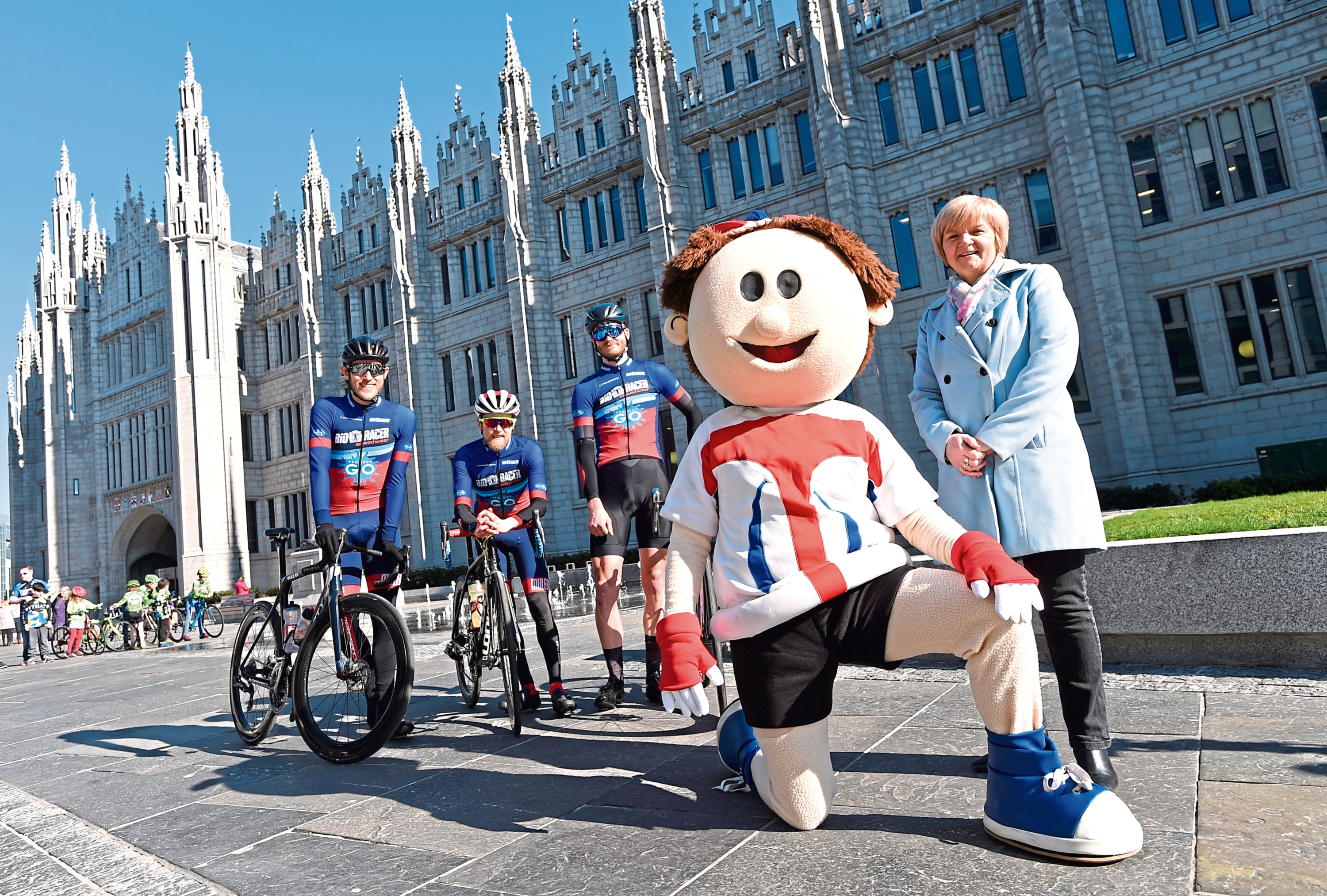 Cyclists, from left, Tom Gelati, David Reed, Jamie Davidson, OVO Energy Tour Series mascot ToBi and Aberdeen City Council co-leader Jenny Laing at the launch of the Aberdeen leg of the tour series outside Marischal College