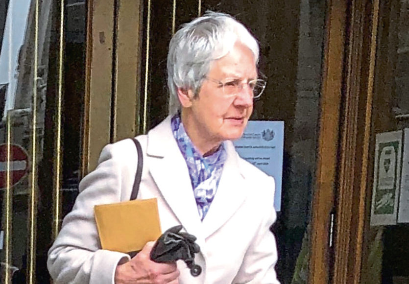 Stella Masson, 82, leaving Aberdeen Sheriff Court after being fined for playing loud music and banging on walls