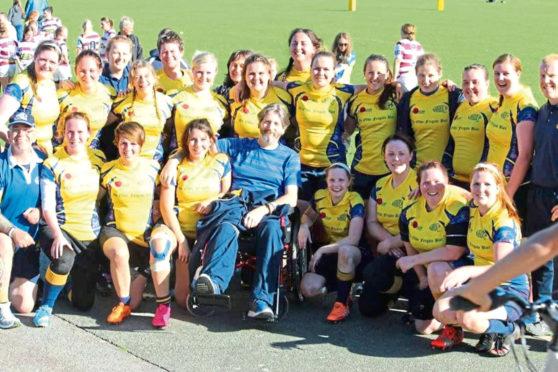 Tim Harris with his beloved Garioch Ladies Rugby Club team