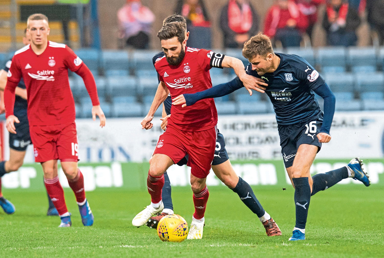 Aberdeen captain Graeme Shinnie in action.