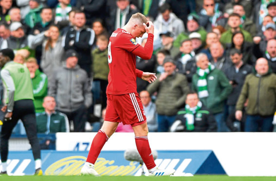 Aberdeen's Lewis Ferguson walks off after receiving a straight red card against Celtic at Hampden.