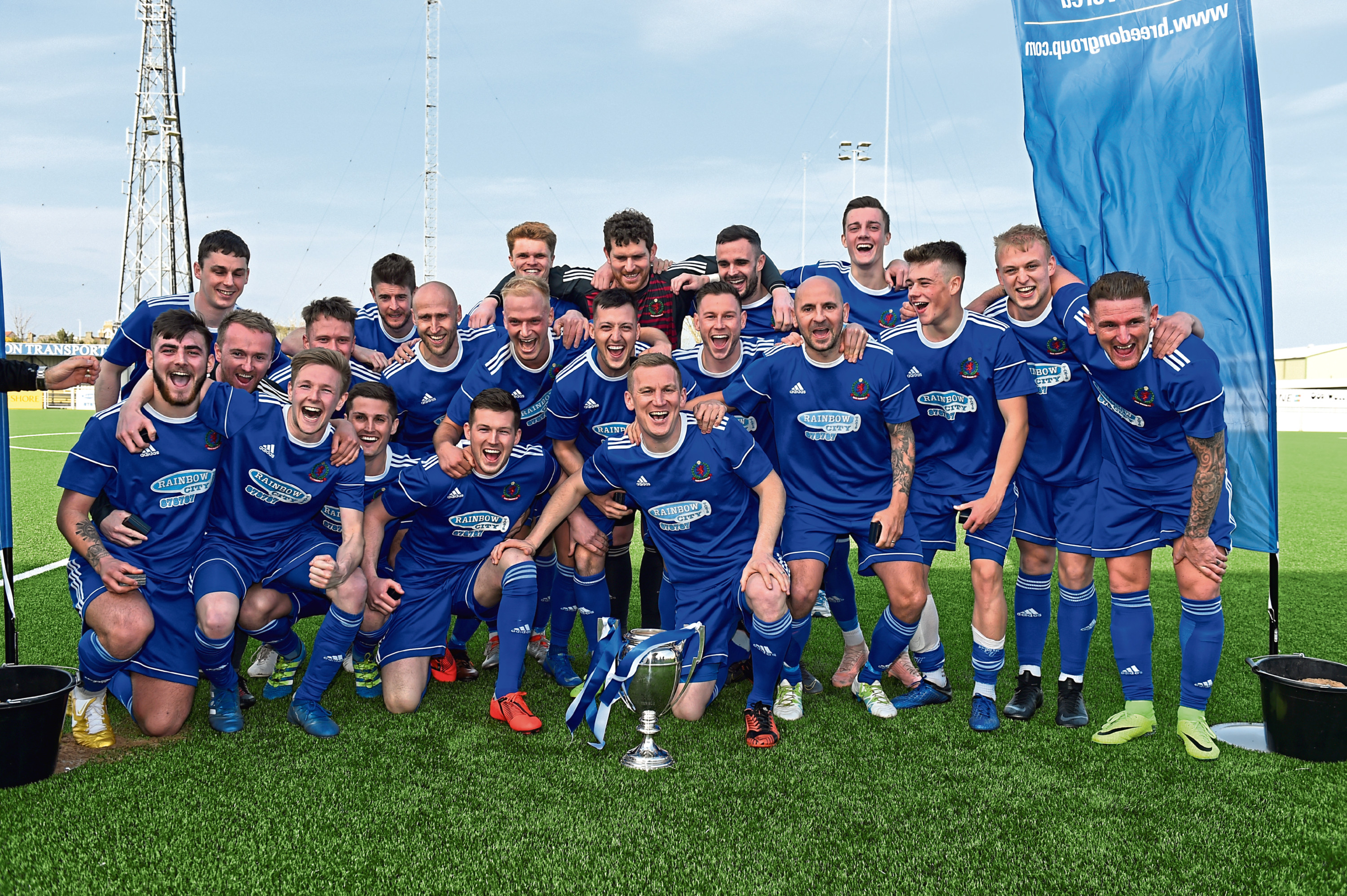 Cove Rangers celebrating with the Highland League trophy.