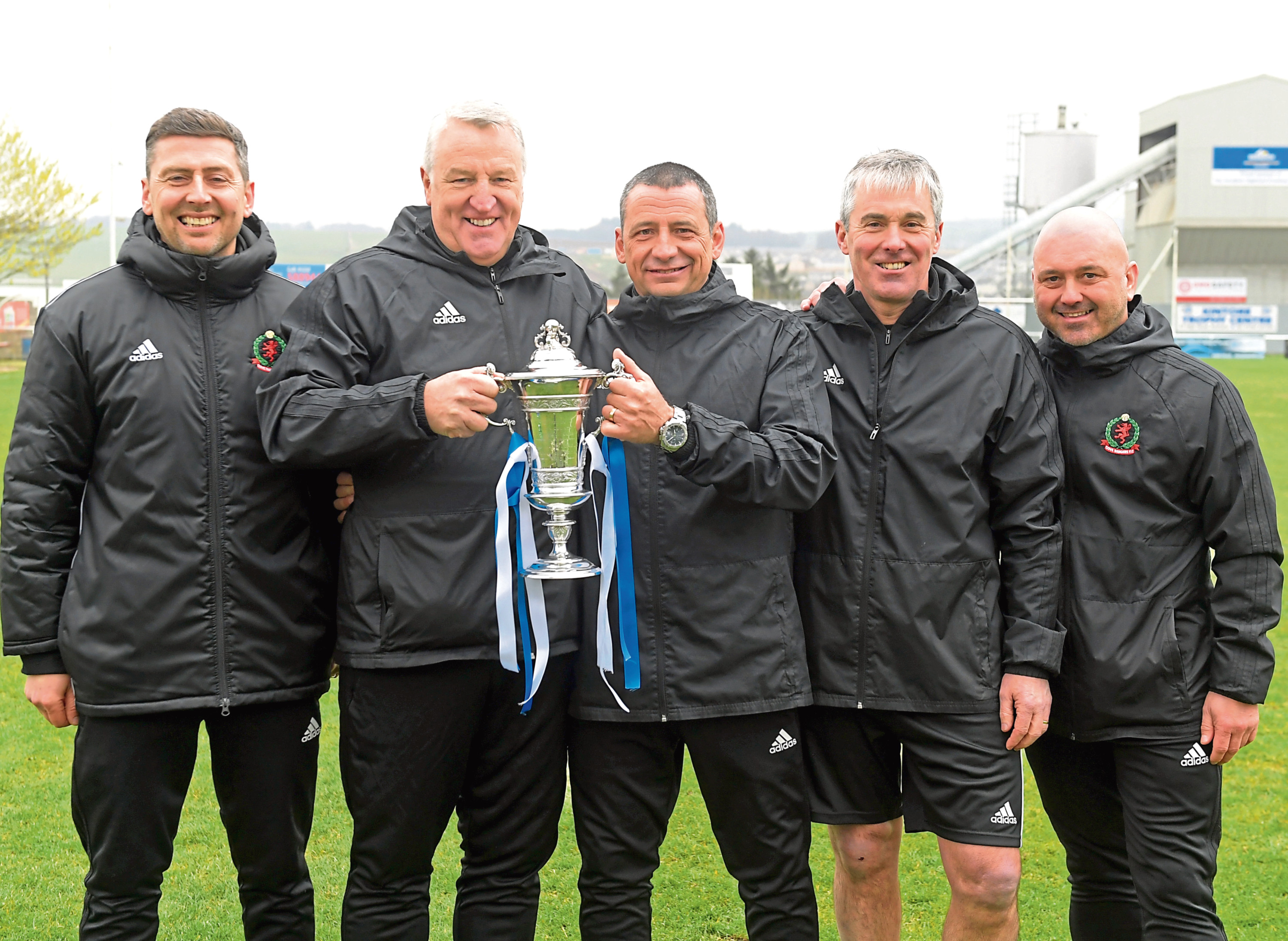 Cove's John Sheran and his team with the Highland League Cup. Graeme Mathieson is to his right.
