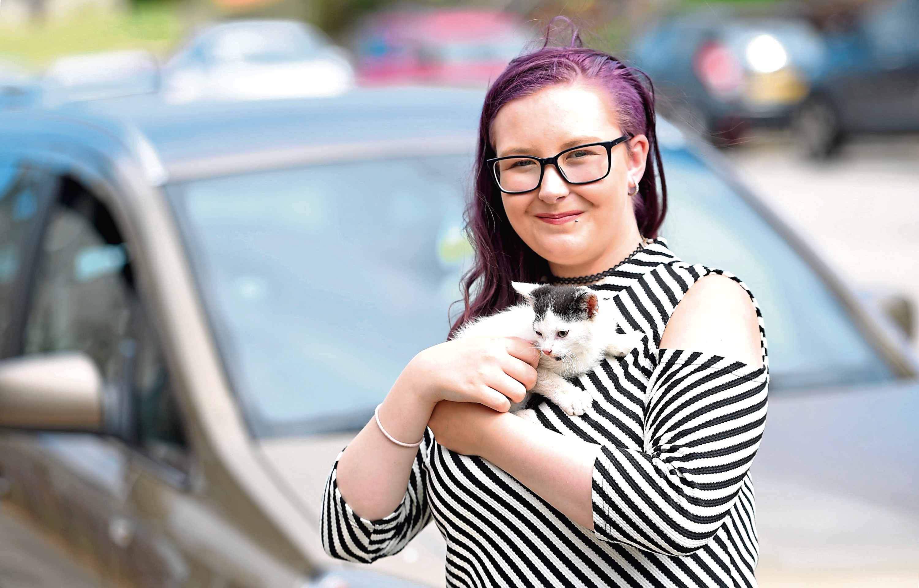 Zoe Duncan with Heidi the kitten which had to be rescued by firefighters after becoming stuck in the dashboard of a car