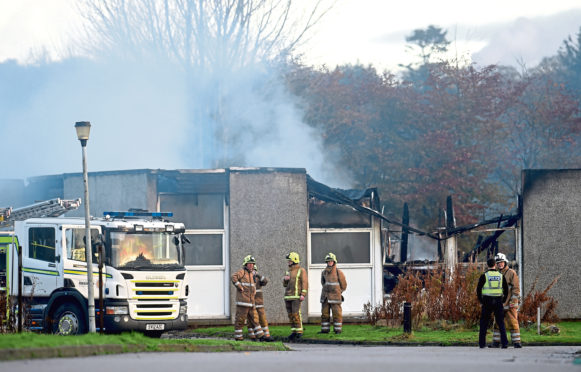 Firefighters at the scene of a large fire at Cordyce School, Dyce.