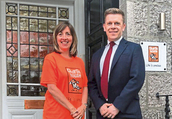 Charlie House's director of fundraising Susan crighton with Tim Stevenson
