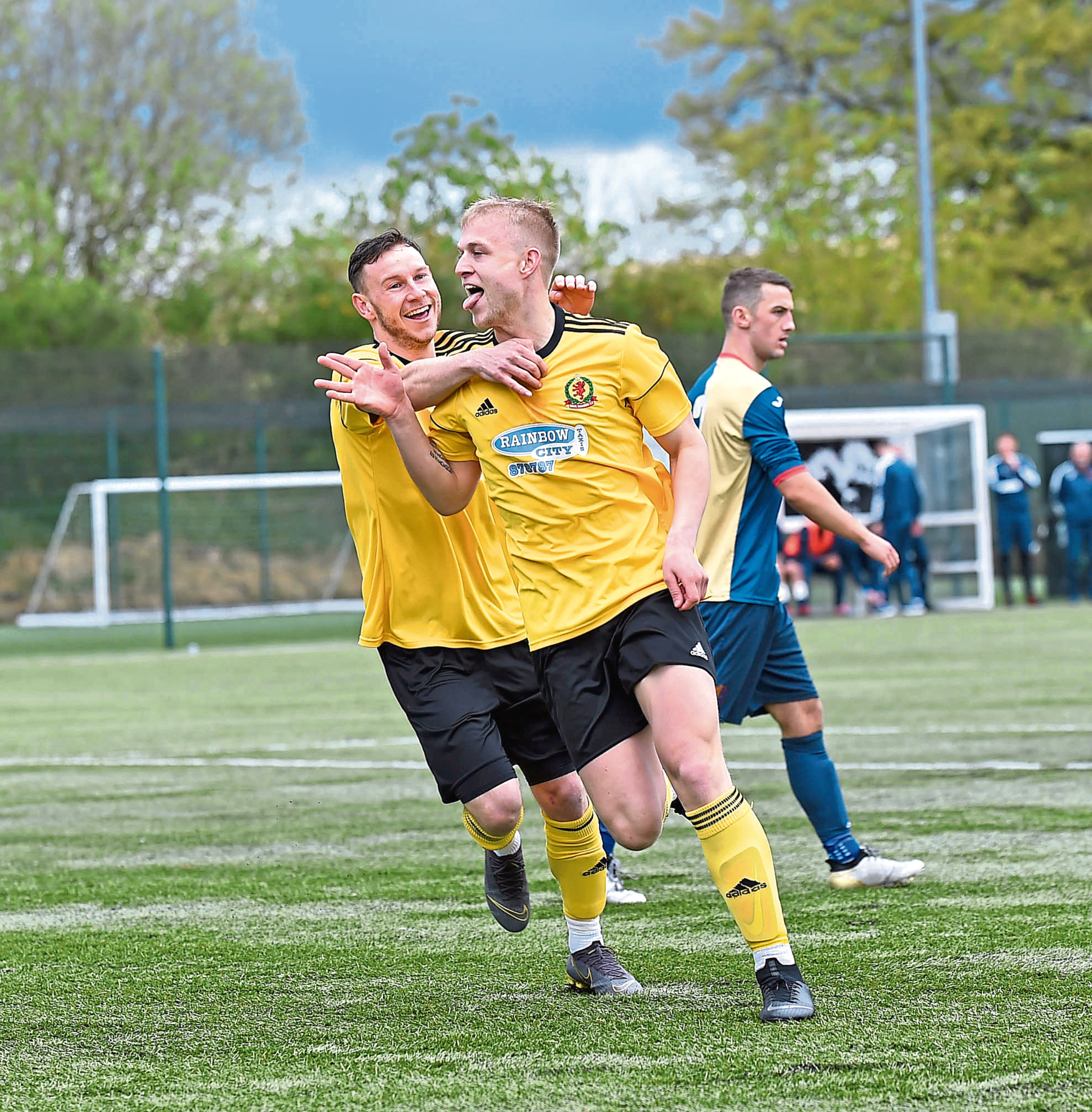 Harry Milne (right) races away to celebrate after scoring Cove's first goal against East KIlbride.