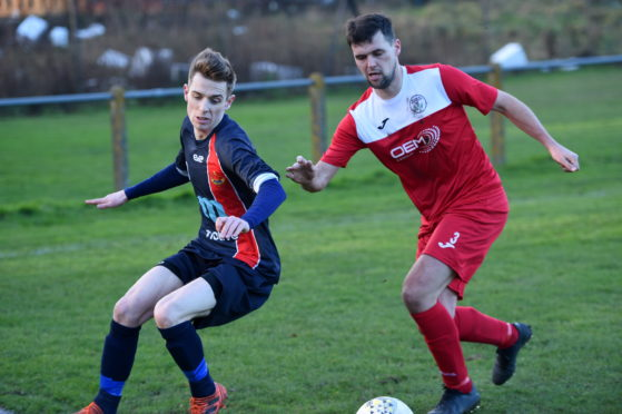 Hall Russell United's Andrew Davidson and Thistle's Lewis Shand
