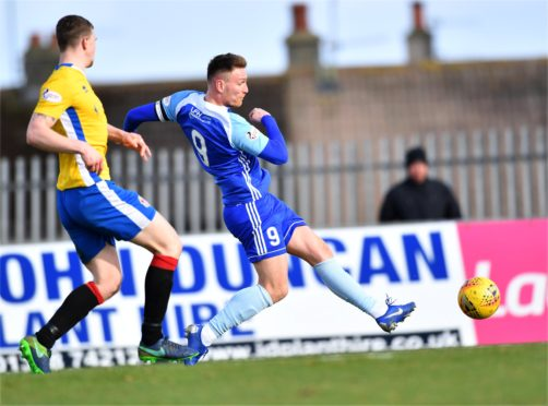 Rory McAllister scoring Peterhead's first.