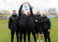 Cove's John Sheran and his team with the trophy, including Graeme Mathieson, centre.