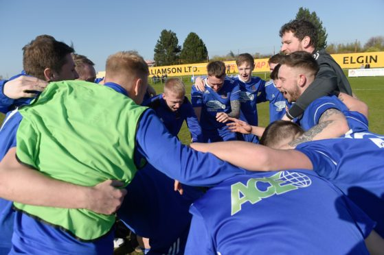 The Cove team and management celebrate winning the title at Forres.