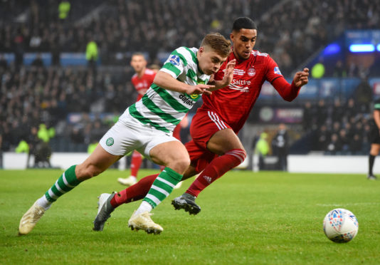 Celtic's James Forrest holds off Aberdeen's Max Lowe in the Betfred Cup final.