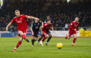 Aberdeen's Sam Cosgrove scores from the spot against Dundee las