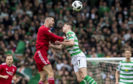Celtic's Ryan Christie suffers an injury, left, after a clash with Aberdeen's Dominic Ball.