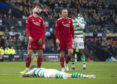 Aberdeen's Mikey Devlin after fouling Jonny Hayes for Celtic's penalty.
