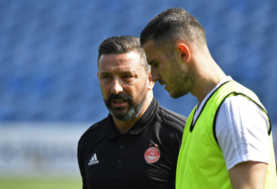Aberdeen manager Derek McInnes, left, in discussion with Dominic Ball.