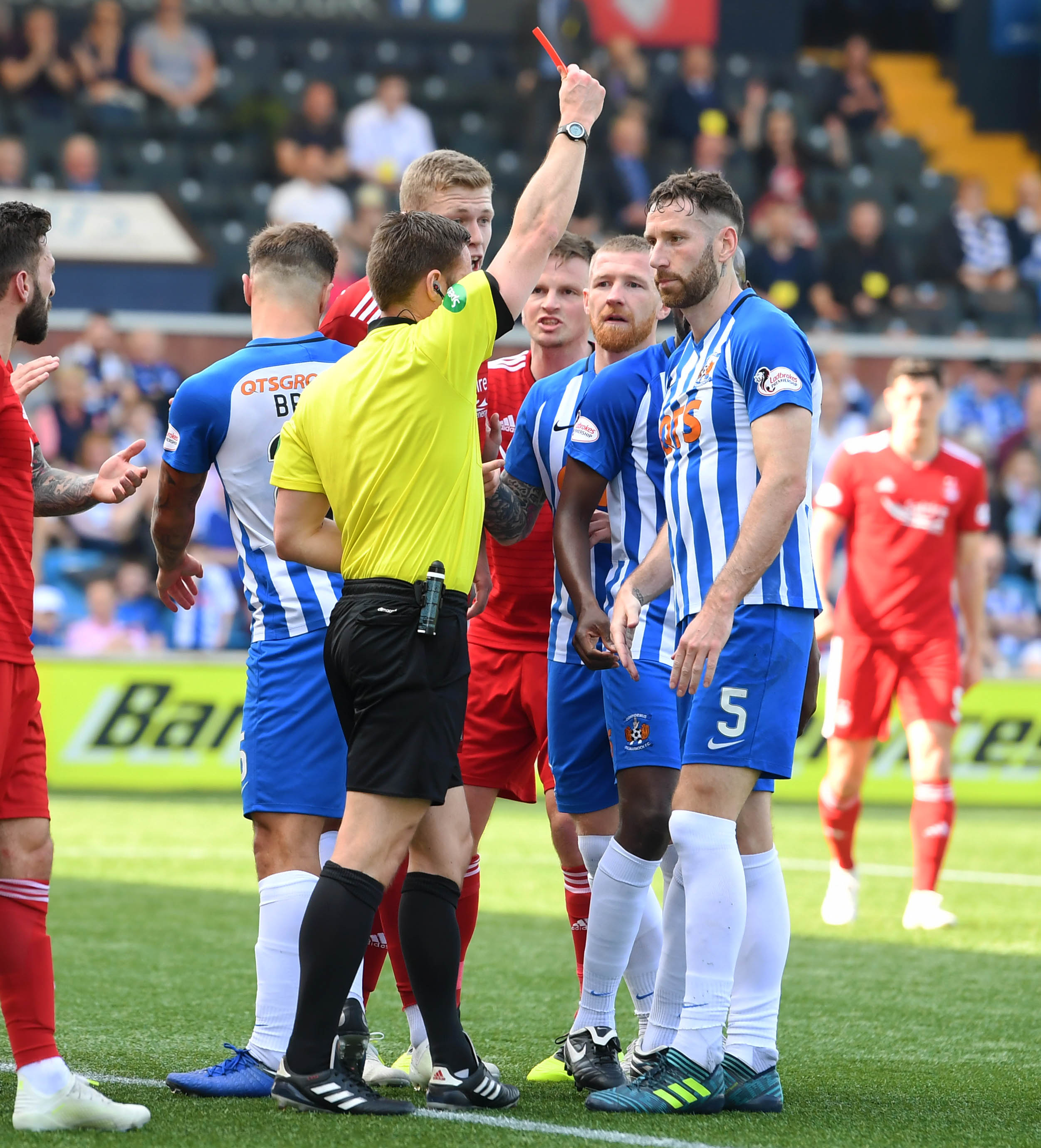 Referee Steven McLean shows Kilmarnock's Kirk Broadfoot a straight red card.
