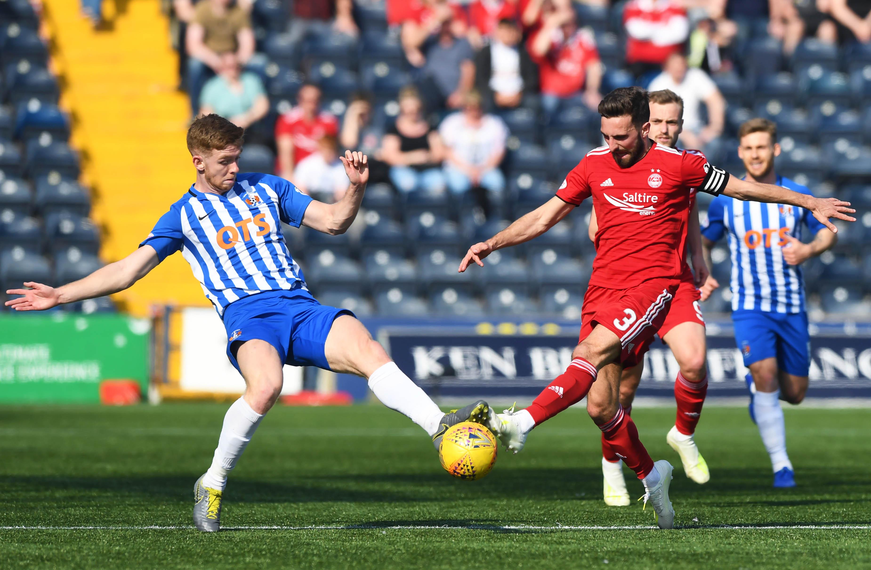 Kilmarnock's Stuart Findlay, left, challenges Aberdeen's Graeme Shinnie and is sent off.