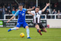 Peterhead's Rory McAllister, left, and Stephen Bronsky in action.