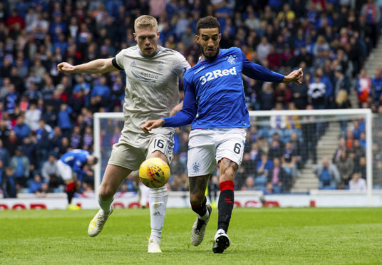 Aberdeen's Sam Cosgrove (left) in action with Rangers' Connor Goldson.