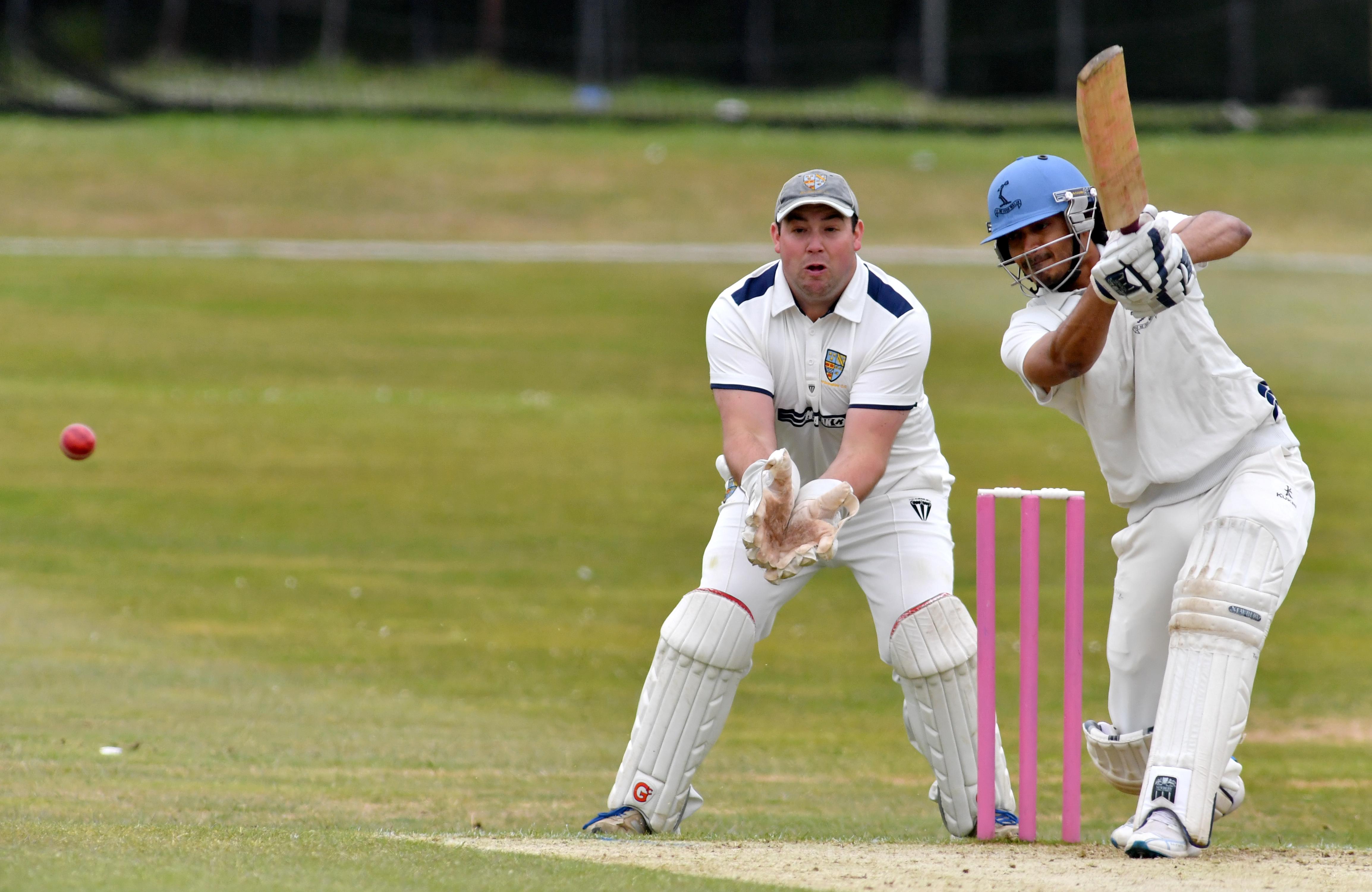 Aberdeenshire's wicket keeper Kenny Reid and Carlton batsman Arun Pillai.  Picture by Kami Thomson
