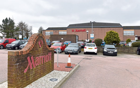 The man was found with a serious head injury  at the Marriott