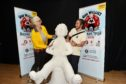 Artists Fiona Chance and Chris Bissett with one of the Oor Wullie statues which will form part of the trail