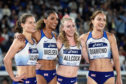 Zoey Clark, Laviai Nielsen, Amy Allcock and Emily Diamond of Great Britain pose during round 1 of the Women's 4x400m Relay day one of the IAAF World Relays at Nissan Stadium.