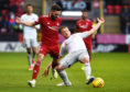 Aberdeen's Graeme Shinnie, left, competes with Hearts' Oliver Bozanic.