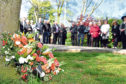 A wreathe was laid during a ceremony at Johnstone Gardens