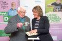 Childline founder Esther Rantzen with Norman Hutchison, the oldest volunteer