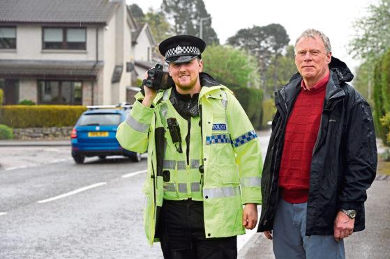 PC Brendan Clarke and Peter Roberts