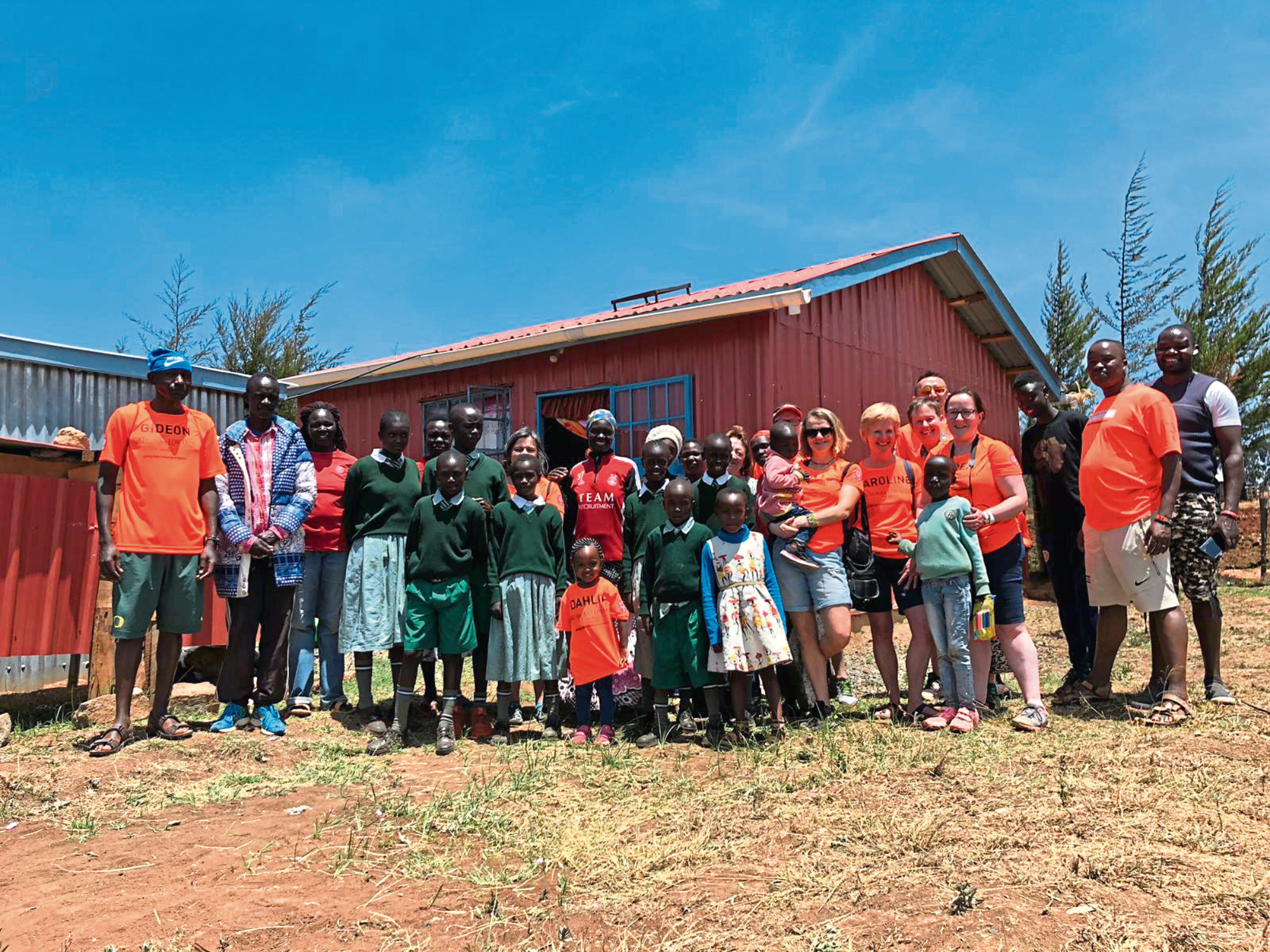 Kenya 22 volunteers on their recent trip out to the country helped build the charity's 34th house for people in need