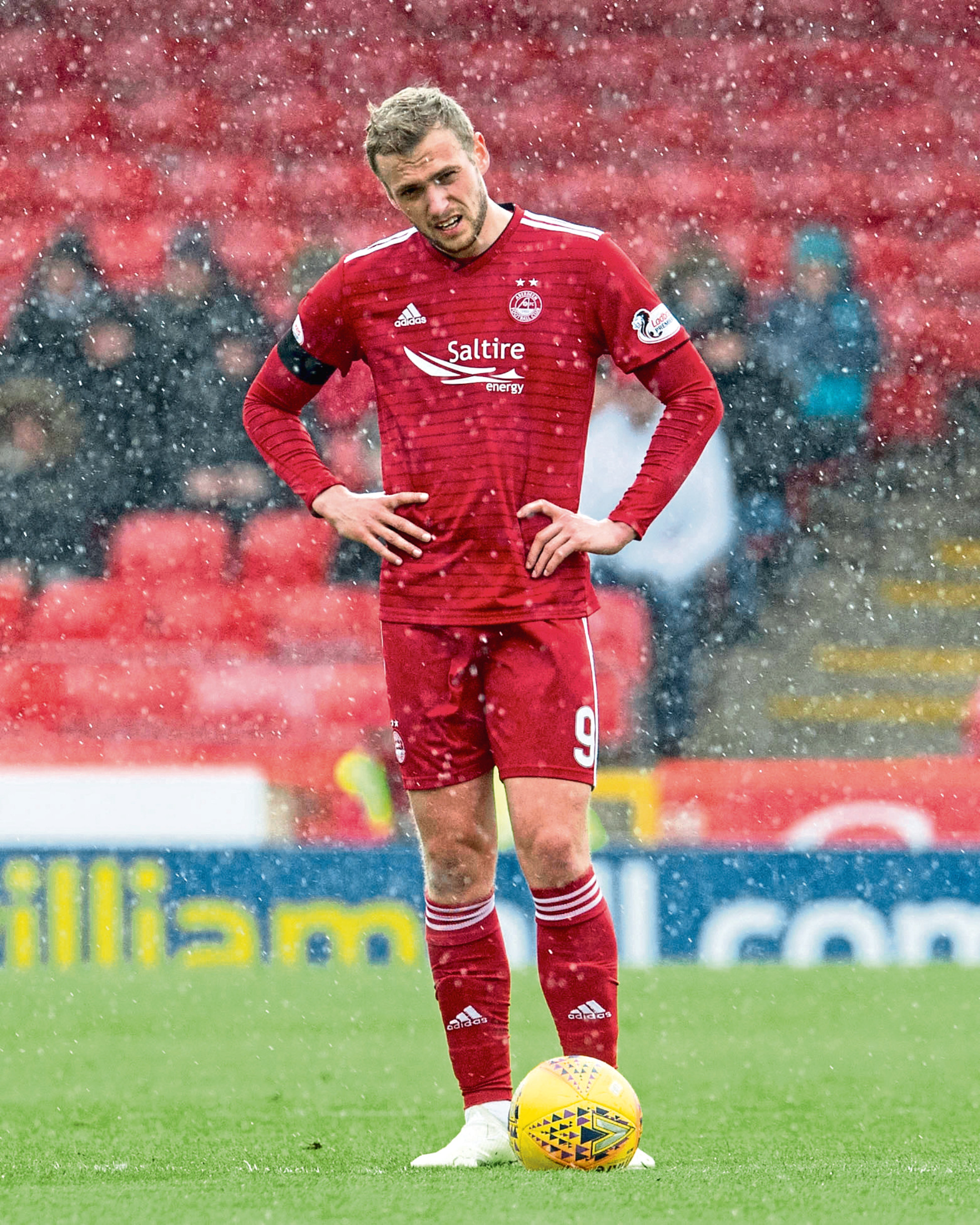 Aberdeen's James Wilson looks dejected during their game against Celtic at Pittodrie